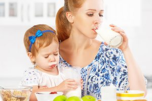 Young Mother Drinking Milk